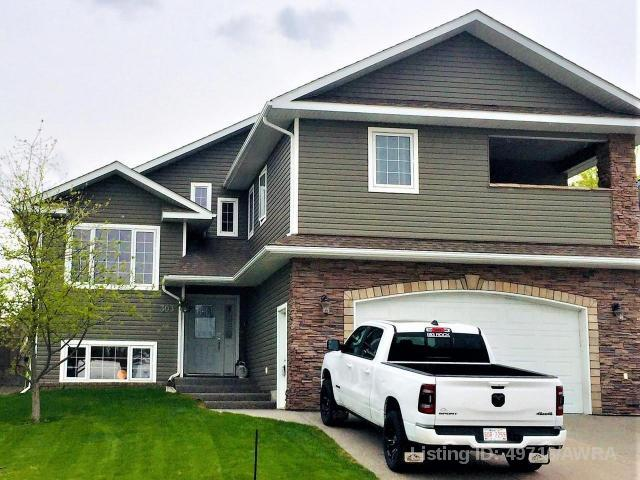 303 Tocher Ave, 5 bed, 3 bath, at $575,000