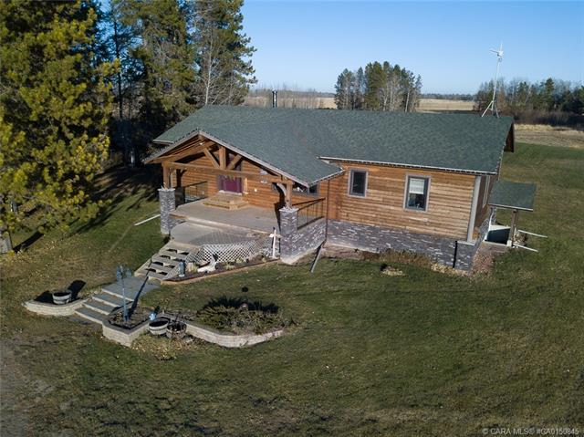 392039 A B Range Road 65, 5 bed, 2 bath, at $695,000