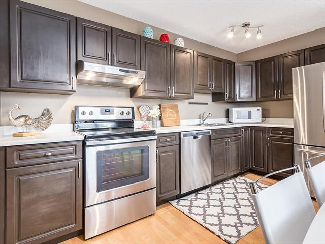 1 3620 51 ST SW, Calgary, Alberta | MLS® # C4198558 | Calgary Real Kitchen Cabinets In Calgary on decorative beams in kitchen, rubber floor in kitchen, faux finish walls in kitchen, utility shelves in kitchen, sectionals in kitchen, two tone paint in kitchen, credenza in kitchen, coffee table in kitchen, hardwood floors in kitchen, wood counters in kitchen, wash basin in kitchen, cognac shaker cabinets kitchen, pie safe in kitchen, kitchen island in kitchen, work bench in kitchen, painting walls in kitchen, metal shelving in kitchen, china hutch in kitchen, half bath in kitchen, door handles in kitchen,
