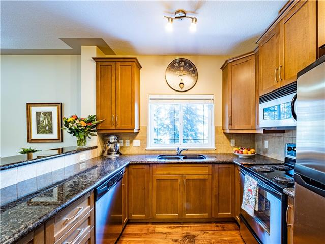 #238 20 DISCOVERY RIDGE CL SW, 2 bed, 2 bath, at $389,900
