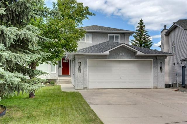 307 SANDALWOOD CL NW, 5 bed, 4 bath, at $599,900