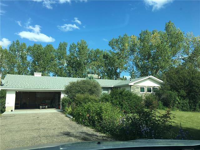 19.2 Acres/Home North of Okotoks 5 mins. ST E, 3 bed, 3 bath, at $1,199,000