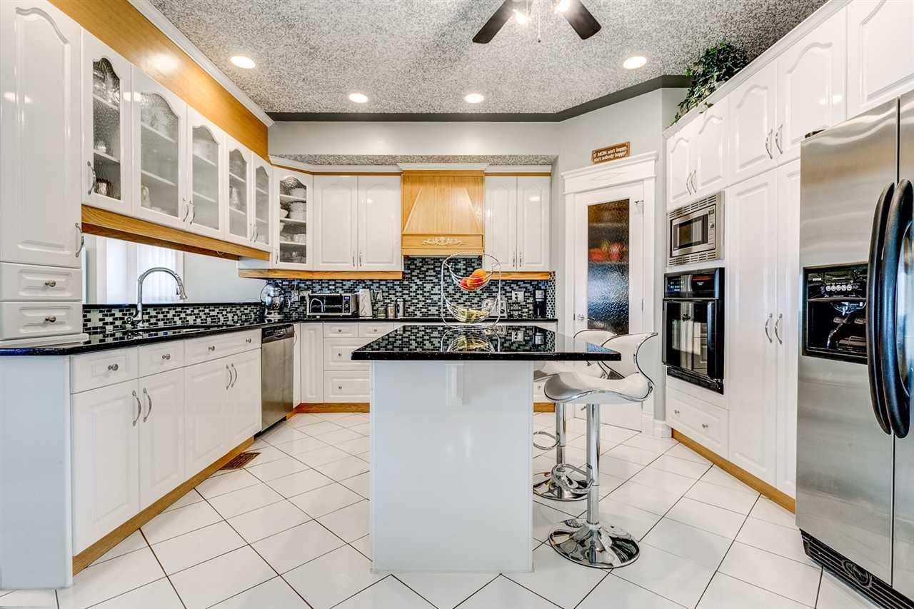 144 64 Street SW, 7 bed, 5 bath, at $650,000
