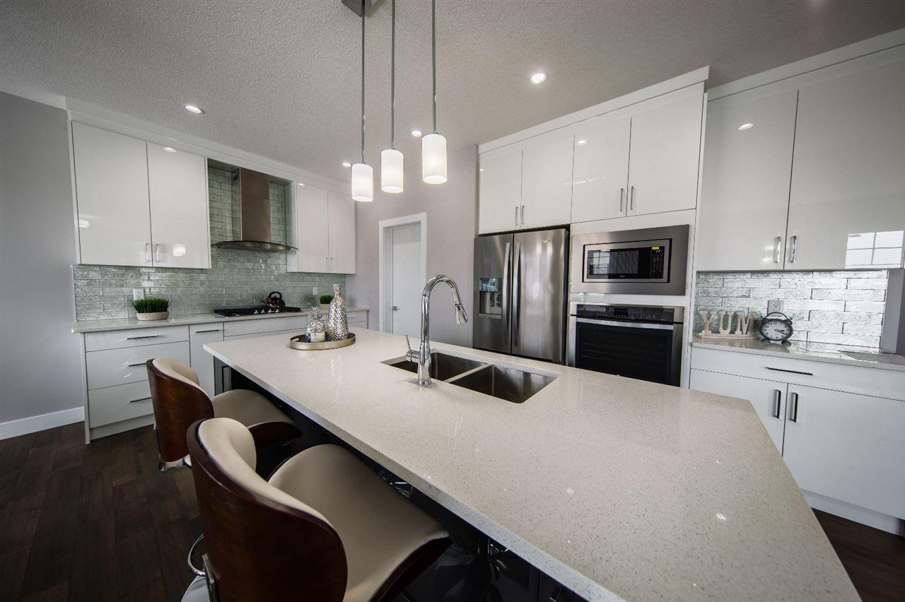 6028 19 Avenue, 5 bed, 4 bath, at $649,900