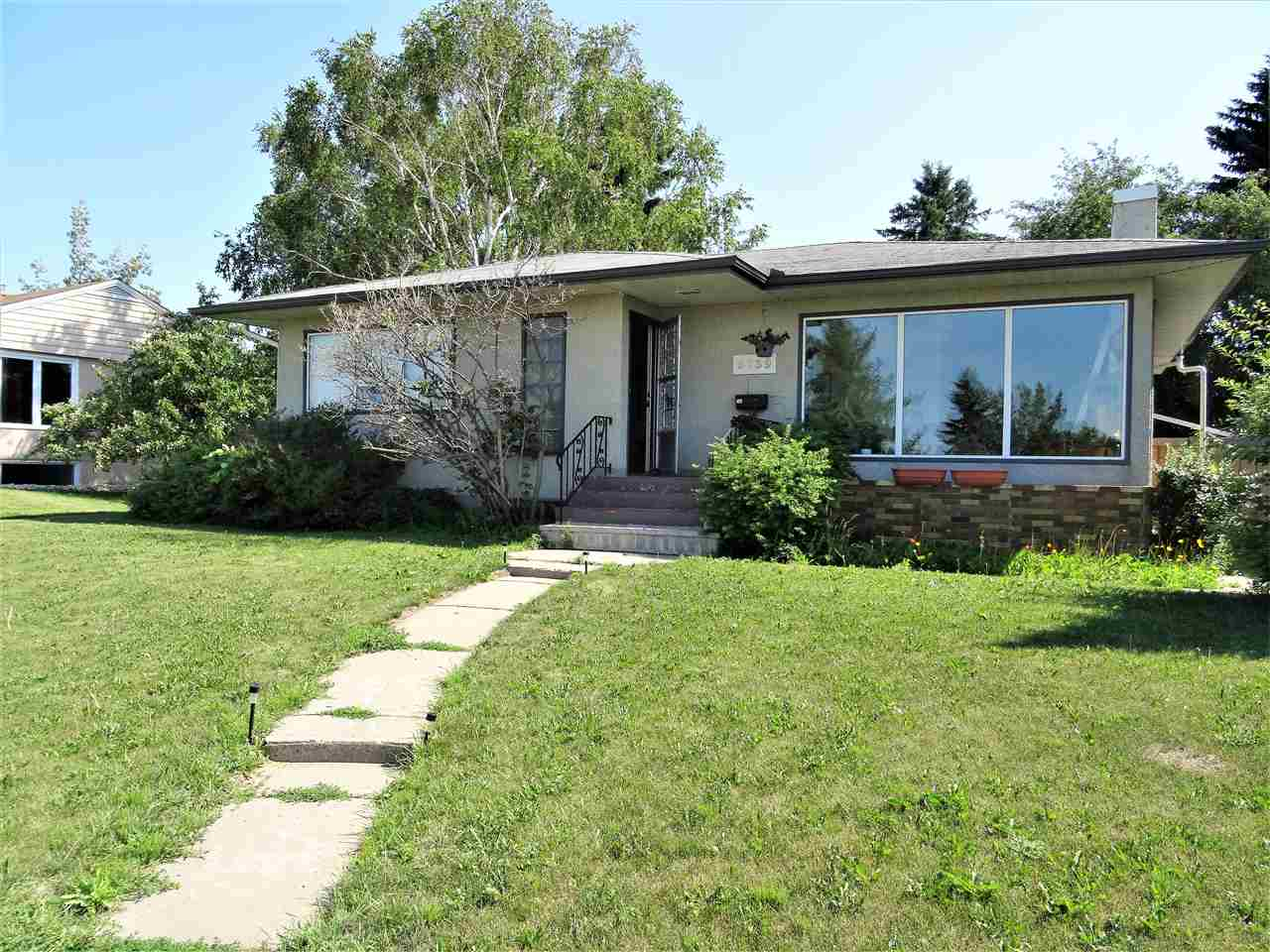 8739 Strathearn Crescent NW, 3 bed, 2 bath, at $810,000