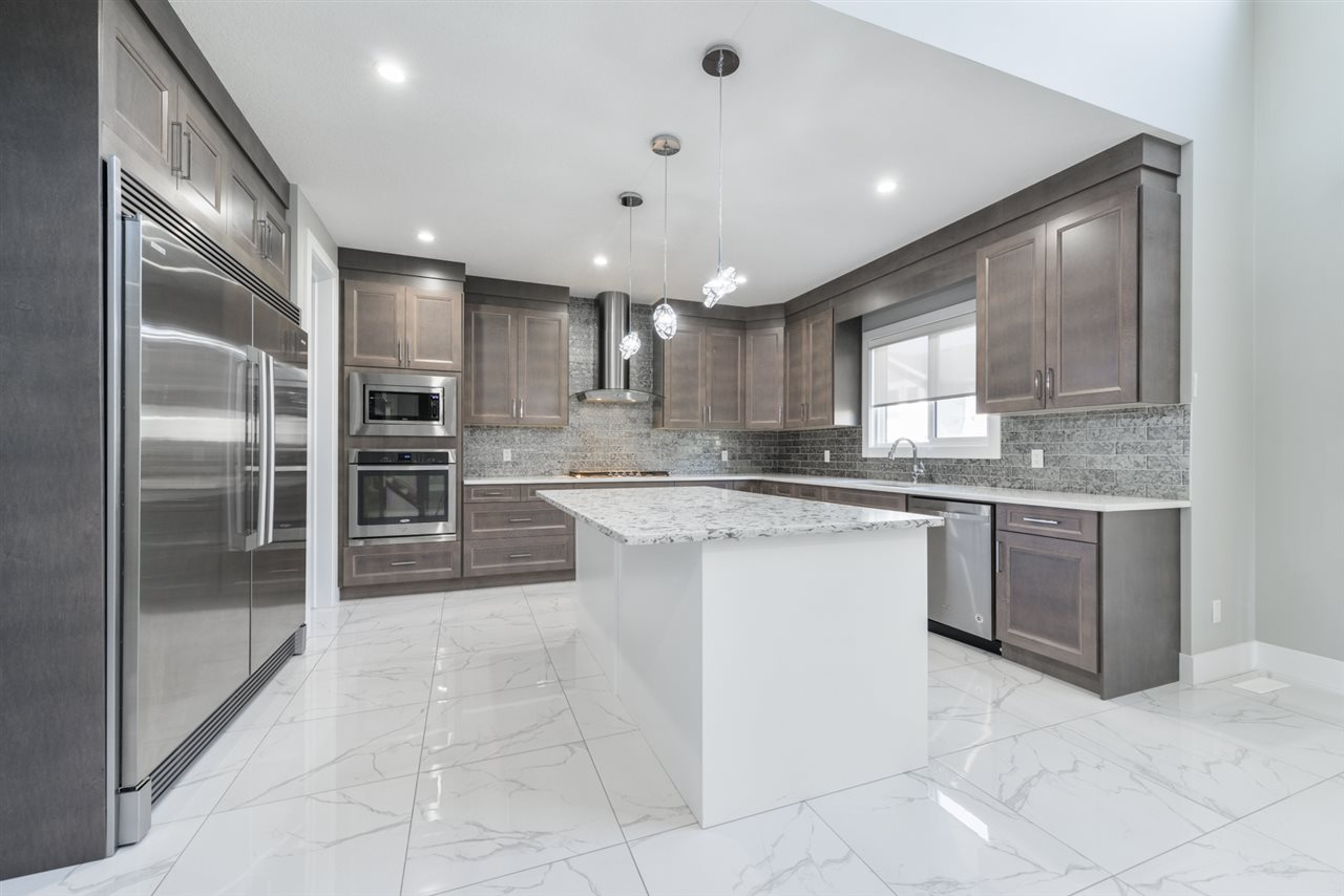 3906 KENNEDY Crescent SW, 4 bed, 5 bath, at $719,800