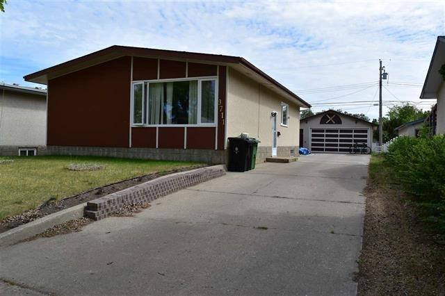9711 94 Avenue, 4 bed, 2 bath, at $229,000