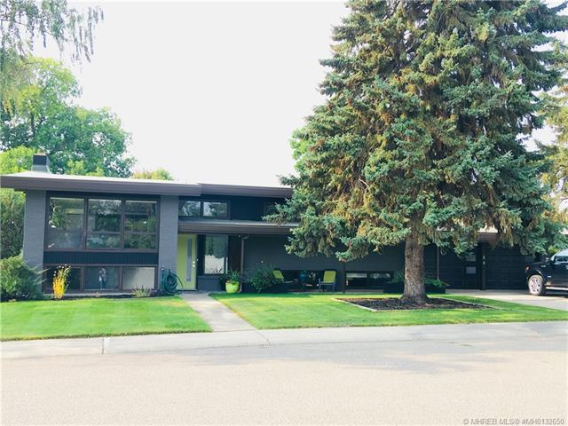 102 6 Avenue NW, 4 bed, 3 bath, at $549,000