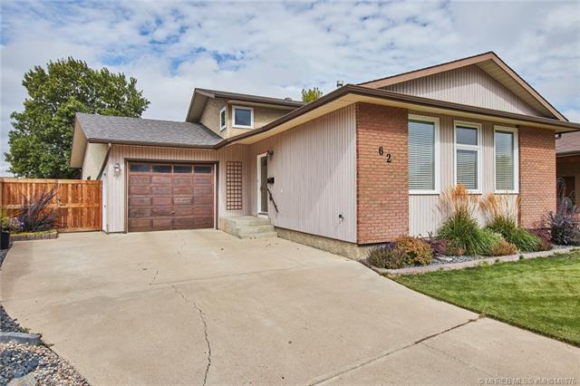 62 Carry Crescent SE, 5 bed, 2 bath, at $332,500
