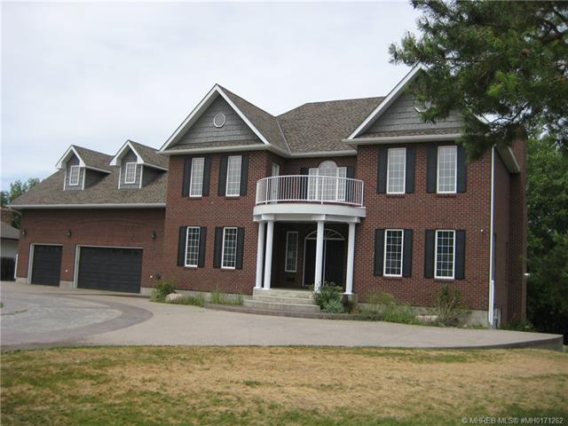 25 8 Avenue SW, 6 bed, 8 bath, at $1,155,000